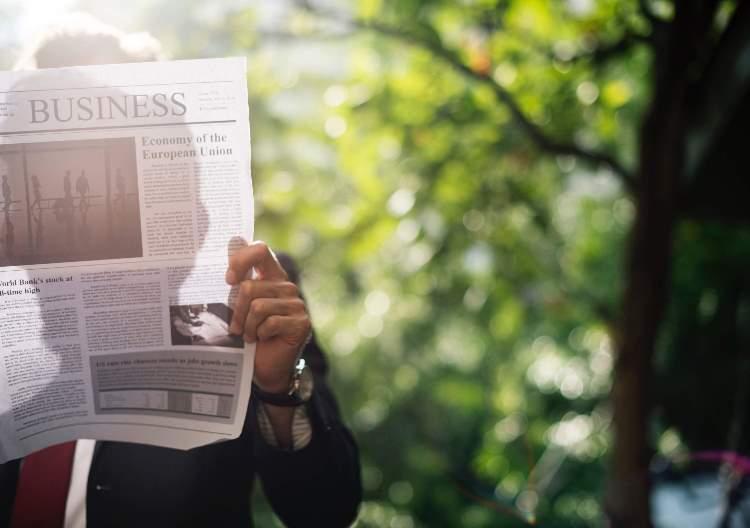 christian dating news man holding newspaper